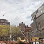Cooper Union's 1858 Foundation Building, left, and its new academic campus, 41 Cooper Square, right. Bebeto Matthews / AP